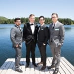 Groomsmen on dock by lake