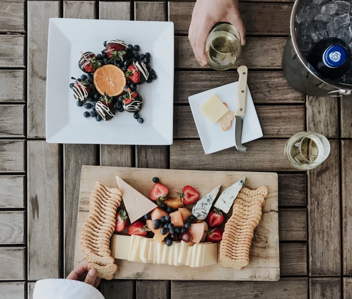 Cheese Platter with crackers and fruit and side of chocolate covered strawberries