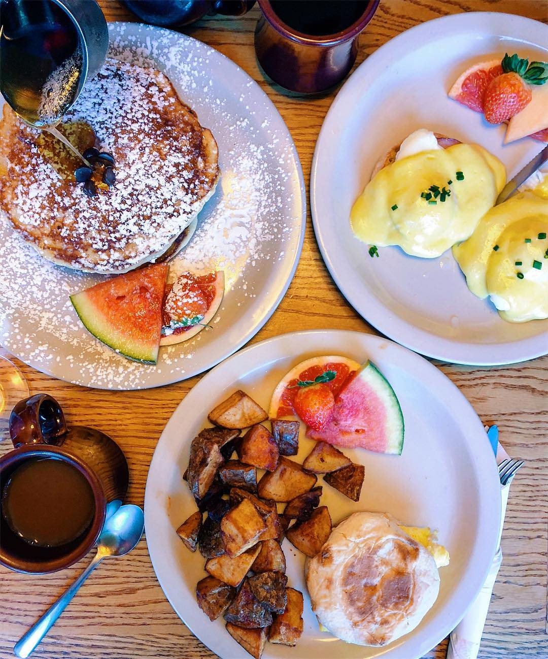 pancakes, homefries, and eggs Benedict. Photo by @foodmoodzz on Instagram